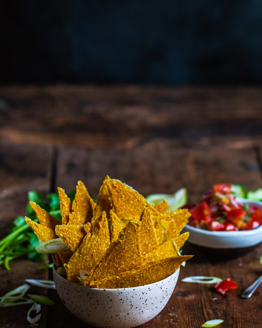 Raw dehydrated corn chips in a white bowl