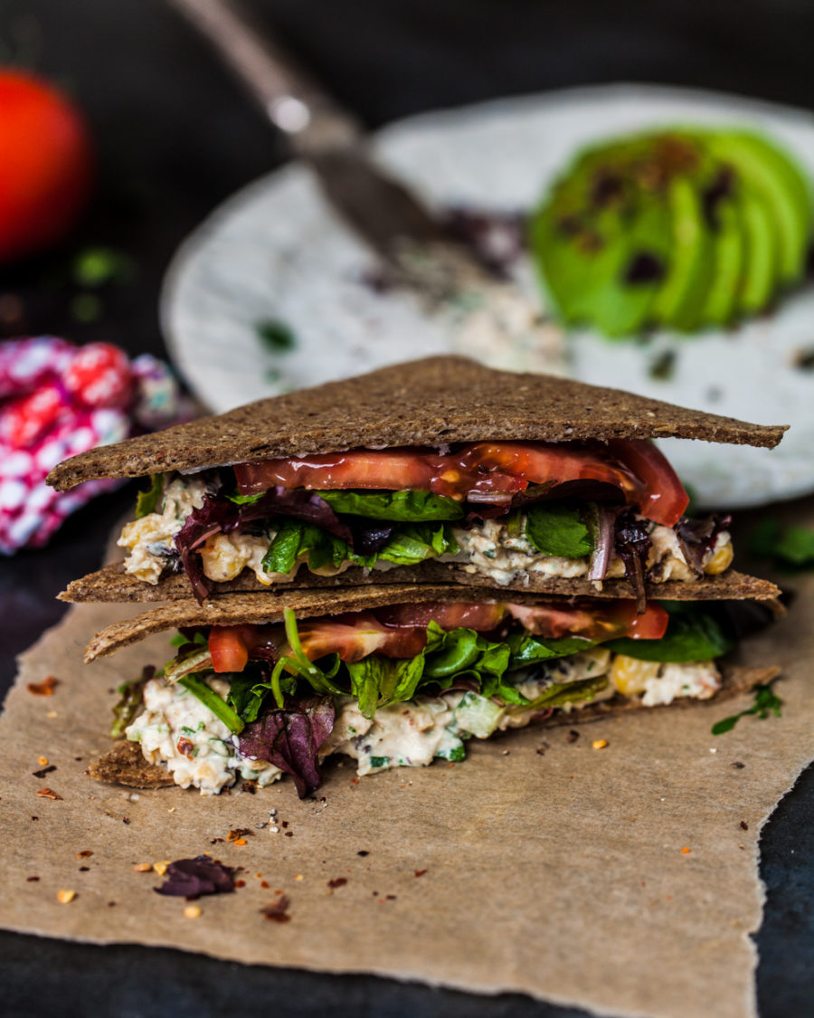 Raw sandwich made with dehydrator chia seed bread on brown paper