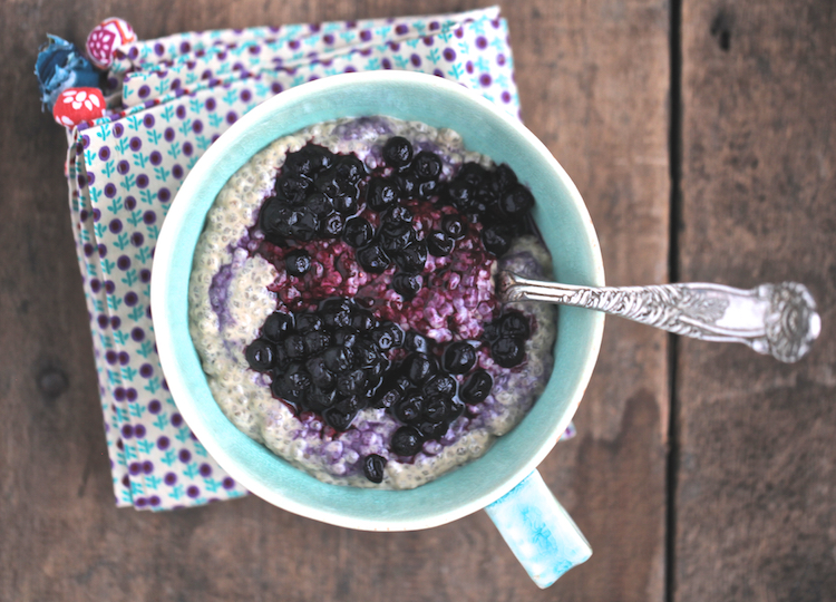 Coconut milk chia in a blue bowl with blueberries