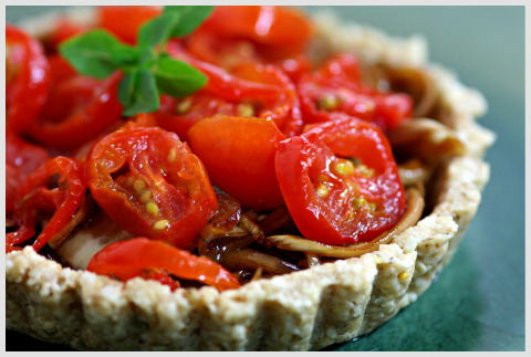 Raw food tomato tart on a green plate