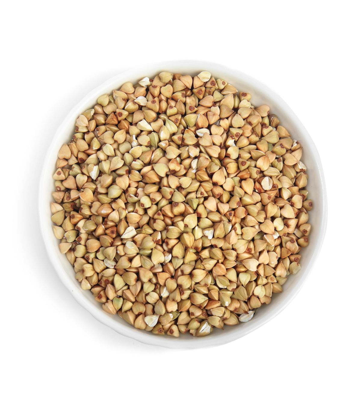 A white bowl full of buckwheat groats on a white background