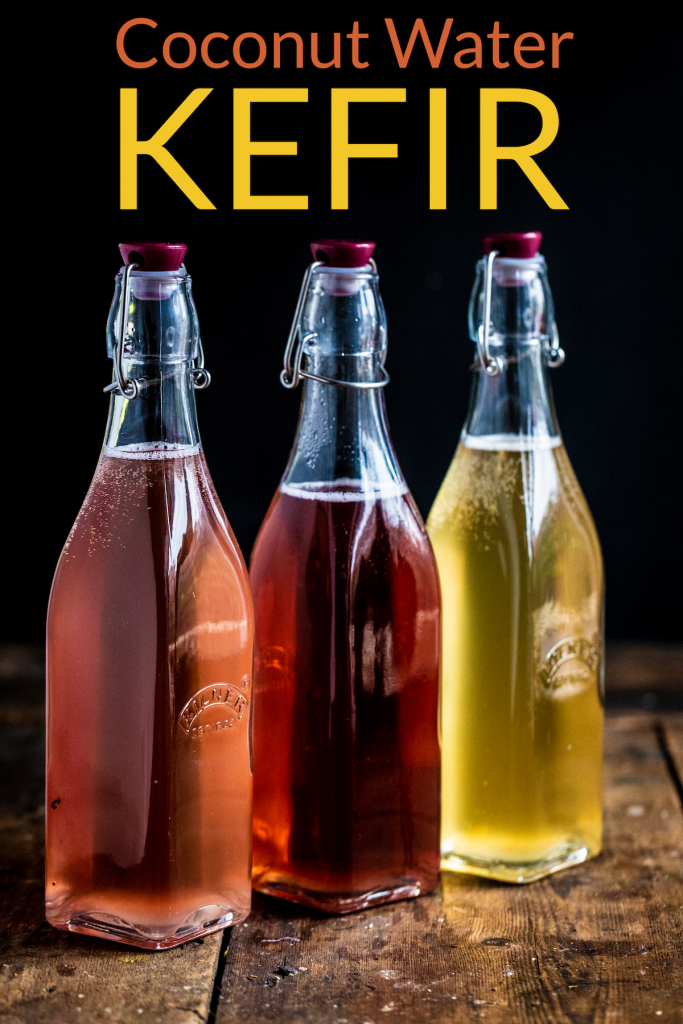 3 bottle of coconut water kefir lined up on a wooden surface