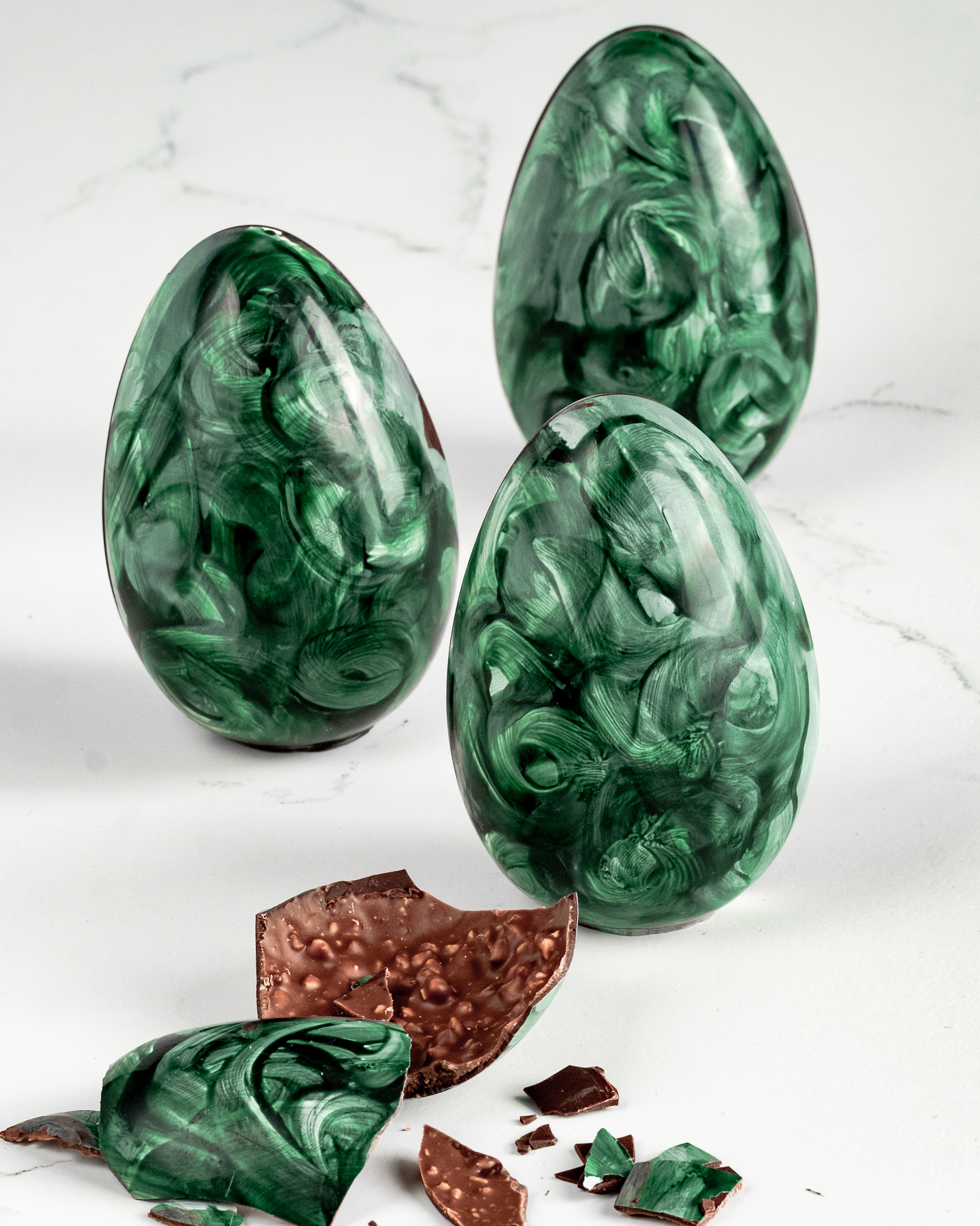 Raw chocolate mint crunch eggs on a white background