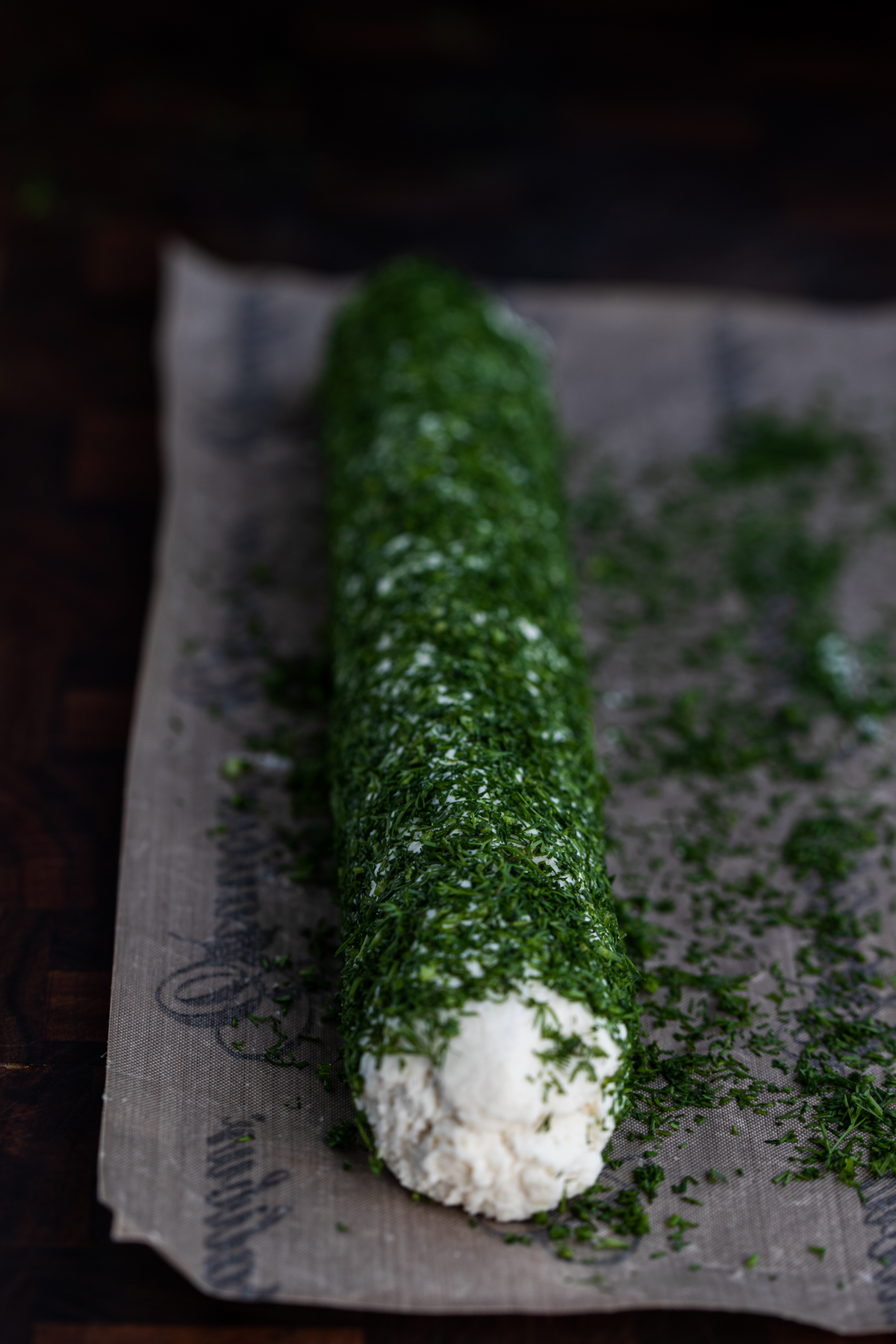 Macadamia nut cheese rolled in dill on a nonstick sheet