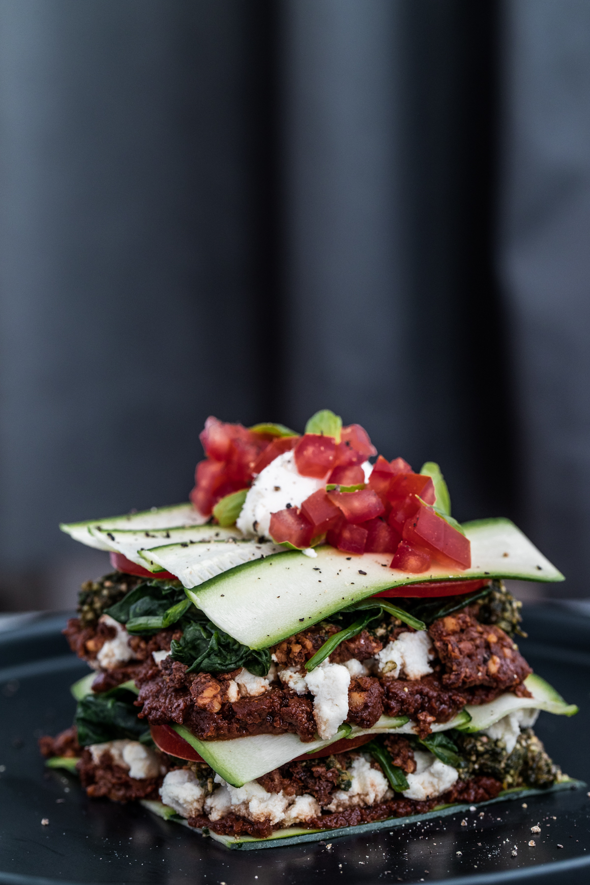 Raw vegan lasagne on a black plate