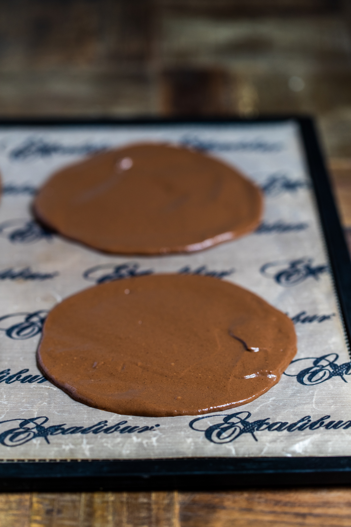 2 cacao crepes spread on a nonstick dehydrator sheet