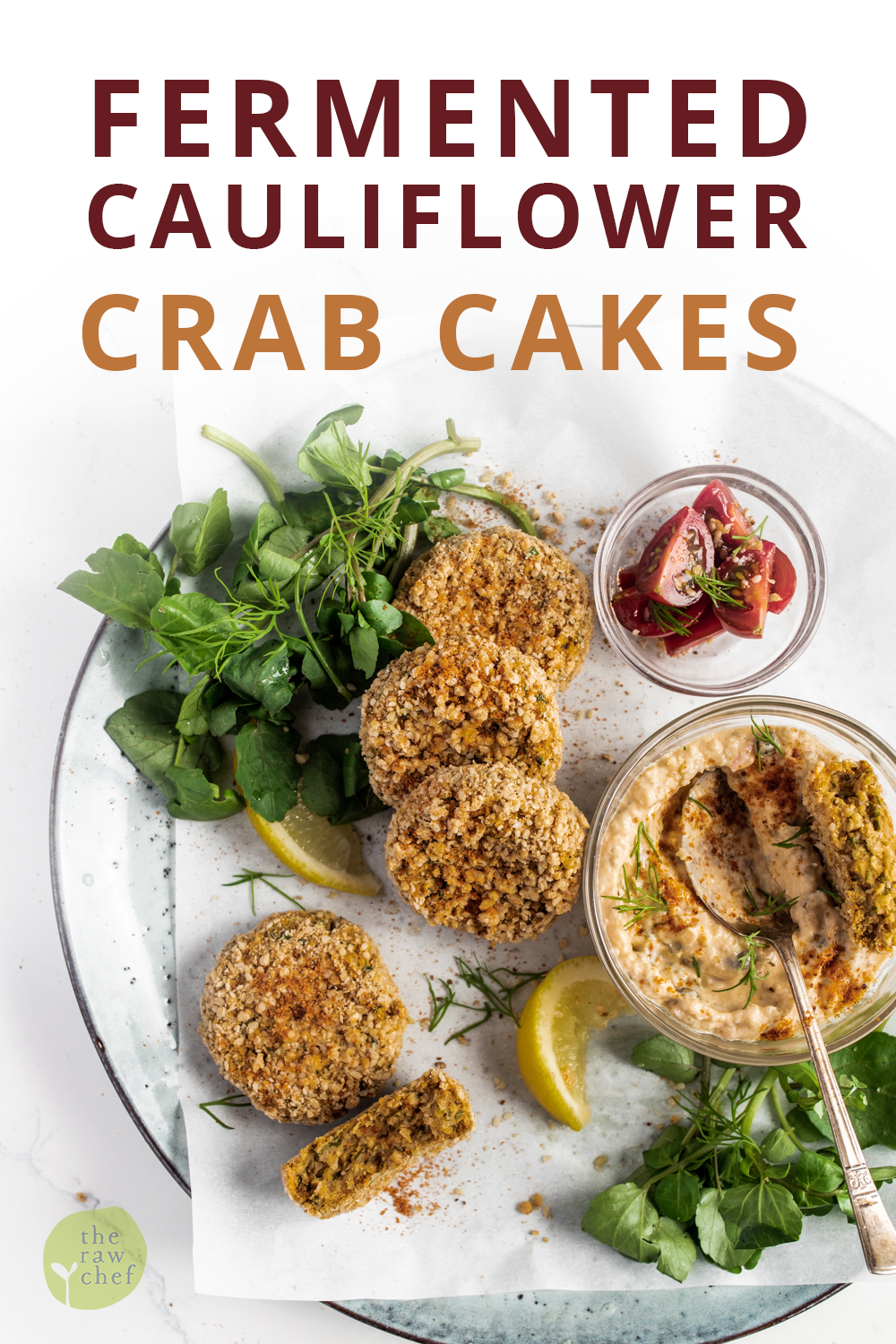 Fermented cauliflower crab cakes with horseradish dipping sauce with watercress on a white background